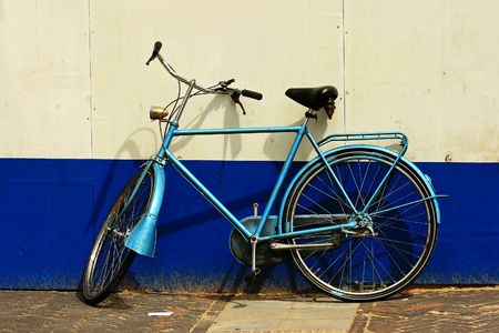 Abandoned bike in front of a painted wall photo