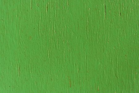 Painted green wall, made of wood, rough surface