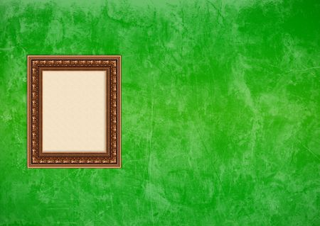 Empty baroque picture frame with copyspace on a green grunge stucco wall photo