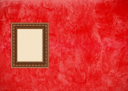 Empty baroque picture frame with copyspace on a red grunge stucco wall photo