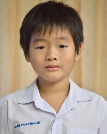 Asian boy in Elementary uniform