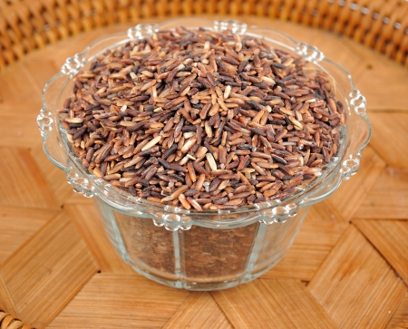Wild brown rice in bowl Stock Photo