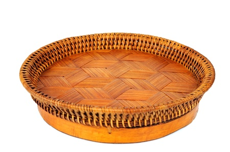 Empty wicker tray isolated on white background photo