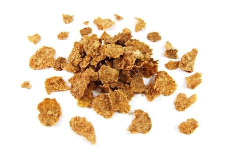 Wholegrain corn flakes isolated on white background Stock Photo - 11323446