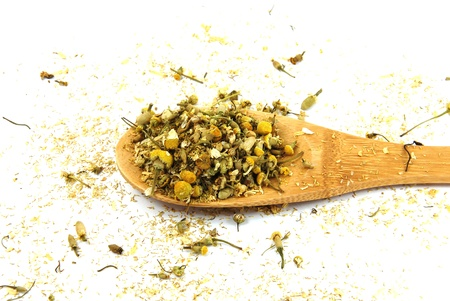 Dry chamomile with wood spoon Banco de Imagens