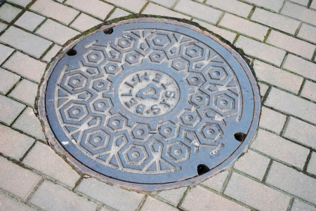 metal grate: fragment manhole cover in the city Stock Photo