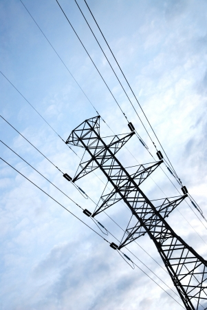 power pole with blue sky background and white clouds photo