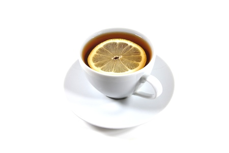 Tea with lemon in the white cup