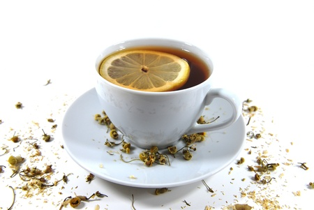 Tea with lemon in the white cup photo