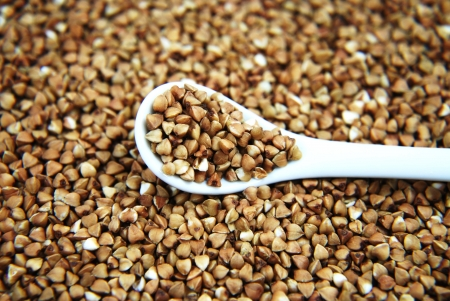 Close up buckwheat with white spoon Stock Photo