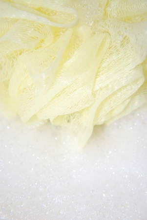 massage yellow bath sponge with water drops Stock Photo - 15757905