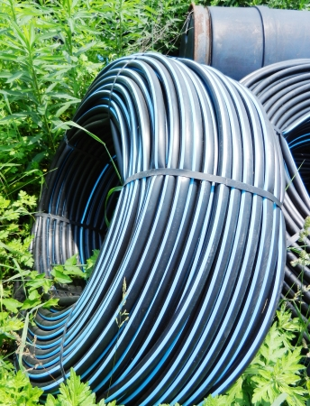 hosepipe: Water supply pipe in farmland Stock Photo
