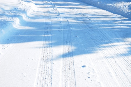 Tire tracks in the snow photo