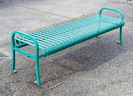 Empty green metal bench