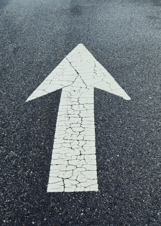 White arrow on Surface traffic Stock Photo - 17996937