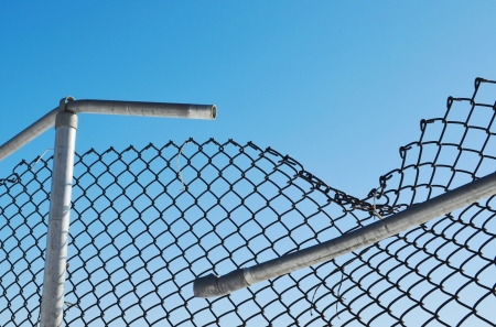 wire fence: broken fence Stock Photo