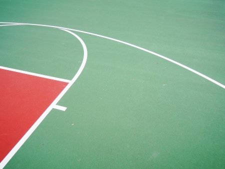 center court: colorful basketball lines on an outdoor court Stock Photo