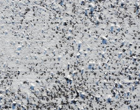 thawed: asphalt with snow Stock Photo