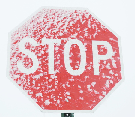stop sign with snow photo
