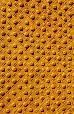 metal grate: Detail of the pattern from a manhole cover