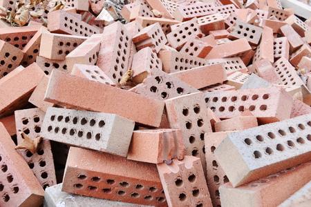 Stack of raw bricks photo