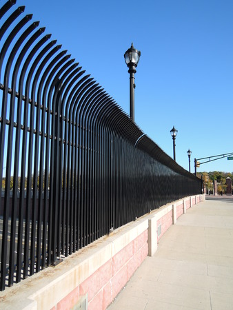 Street and a black steel fence photo