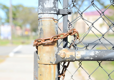 constrain: Chain on the fence Stock Photo