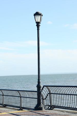 lamp post: Lamp post on the ocean Stock Photo