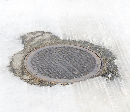 grate: manhole with snow