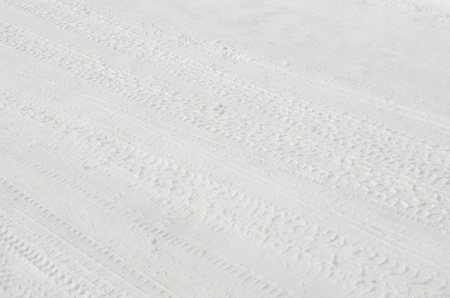 Tire tracks in snow Stock Photo