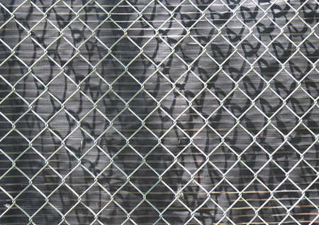 black wall: wire fence