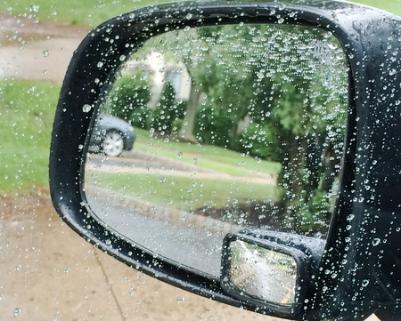 Rain on a car mirror