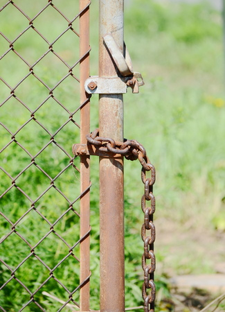Chain on the fence Stock Photo