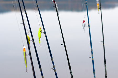 tackle: fishing rods with tackle against the backdrop of the lake Stock Photo