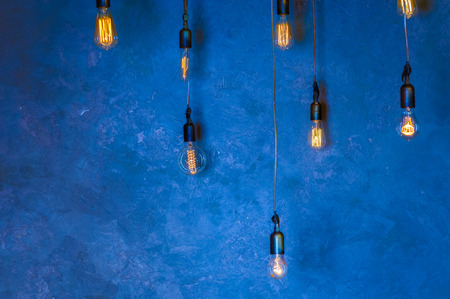lampshades: Edisons light bulb on wall background
