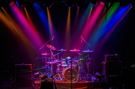 Drum kit on stage in the spotlight color