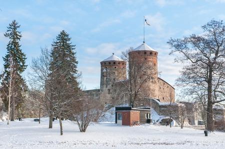Castle Olavinlinna (Olofsborg) on a sunny winter day.  A 15th-ce Stock Photo