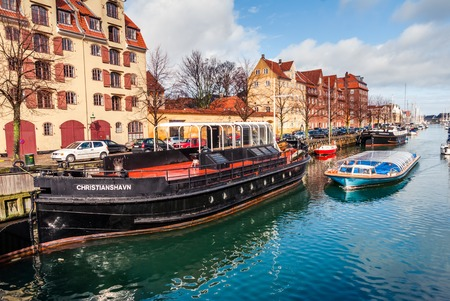 Quay of the Christianshavn canals in Copenhagen with boats, plea