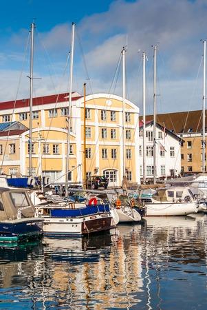 plea: Quay of the Christianshavn canals in Copenhagen with boats, plea