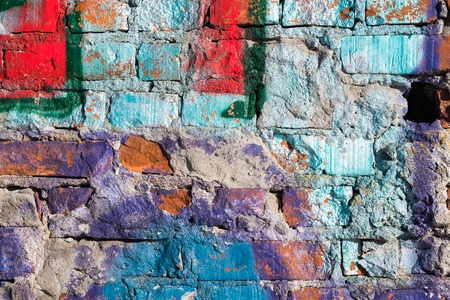 Old brick wall with multicolored stain Stockfoto
