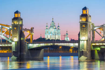 View of the Smolny Cathedral and the Bolsheokhtinsky bridge during the White Nights in June. The inscription on the bridge