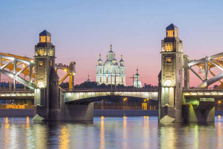 View of the Smolny Cathedral and the Bolsheokhtinsky bridge during the White Nights in June. St. Petersburg. Russia
