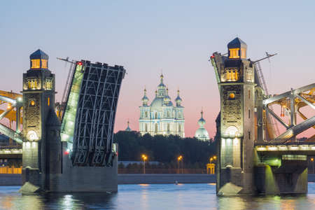 View of the Smolny Cathedral and the divorced Bolsheokhtinsky bridge during the white nights in June. St. Petersburg. Russia