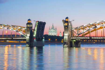 View of the Smolny Cathedral and the divorced Bolsheokhtinsky bridge during the white nights. St. Petersburg. Russia Stok Fotoğraf