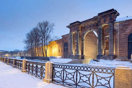 Russia. Arch of the brick building of New Holland in St. Petersburg on the bank of the Moika River on a winter evening. Russia