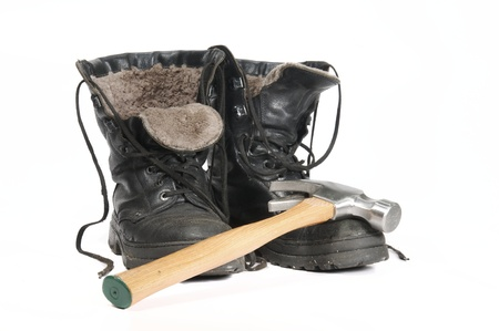 Insulated Winter Construction Boots and Hammer on white background