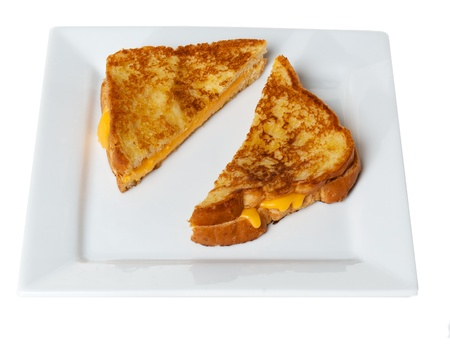Grilled Cheese Sandwich on white plate on white table  Stock Photo