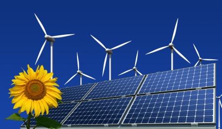 energia renovable: Mono-cristalinas paneles solares, turbinas e�licas y de girasol sobre un fondo azul Foto de archivo