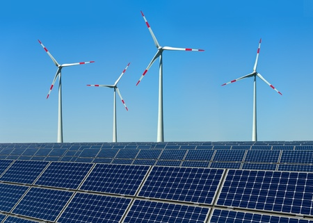 megawatt: Wind turbines and solar panels against a blue sky