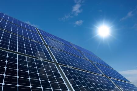 Mono-crystalline solar panels against a sunny sky photo